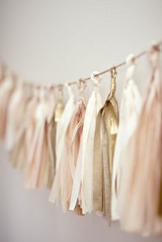 Love tassel bunting, and love these colors. I actually did several of these tassel garlands for our engagement party with white/brown and gold paper | http://bannerandgarland.blogspot.com