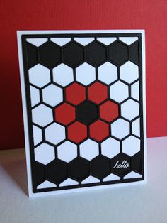 handmade card from I'm in Haven: Hexagon Hello ... black and white with a pop of burgundy ... cover plate hexagon die in black ... like how a flower and lines of unfilled hexagons make patterns for the card ... luv it!!