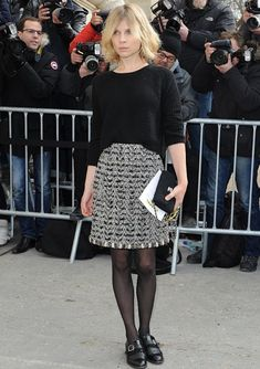 Chanel.....Clemence Poesy, black/white textured patterned skirt, black cropped jumper, black sheer tights & those fab black brogues.