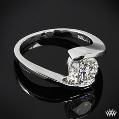 """unique and alluring, """"Lilly"""" Tension Solitaire Engagement Ring. Set with a gorgeous 1.57 ct F VS2 A CUT ABOVE® Hearts and Arrows Super Ideal Round Diamond. It puts a special spin on classic solitaire designs. The tension style setting ensures total security for your diamond without hindering brilliance and shine"""