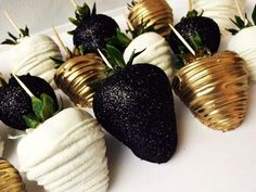 Glamorous chocolate dipped strawberries gold black and white extravagant