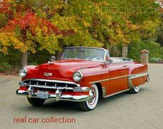 1954 Chevrolet Bel Air Convertible Red Front View On Dirt By Autumn Trees