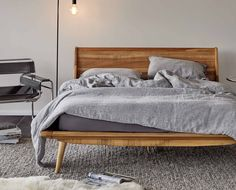 The Nordic-inspired Bolig bed is crafted from solid poplar and features a warm stain exposing the natural texture of the wood. The platform style and tapered legs add a mid-century modern feel. Queen