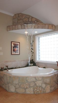 master Bath Stone waterfall feature fills the Bubble jet Tub from above!