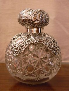 large cut glass and silver globe perfume/scent bottle Antique Perfume Bottles, Vintage Bottles, Perfumes Vintage, Beautiful Perfume, Bottles And Jars, Bottle Art, Cut Glass, Vintage Silver, Art Deco