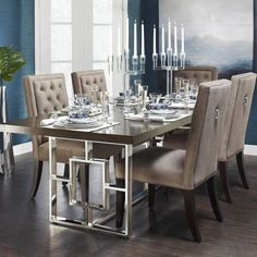 Introducing the Rylan Dining Table. Rylan extends to welcome up to 10 glamorous guests with a graphic stainless-steel base and a layered grey/walnut finish. Take it for a spin with our new Maxwell bistro chairs, at the link in our bio! Luxury Dining Room, Dining Room Design, Dining Room Furniture, Dining Room Inspiration, Dining Chairs, Home Decor, House Interior, Dining Room Decor Elegant, Grey Dining Room