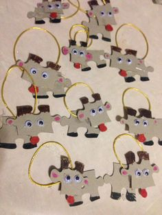 Puzzle Rudolph Christmas ornament. Markers glue string puzzle pieces
