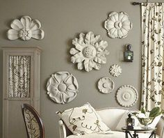 Accessorize your French Country home by hanging small ceiling medallions as rosettes on the wall