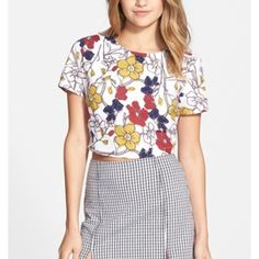 Isabella Rose Taylor Zip Back Crop Top Sketched flowers shaded in primary colors lend a groovy vibe to a sueded crop top finished with a full-length back zipper lined with lace. 100% Polyester. Isabella Rose Taylor Tops Crop Tops