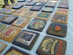 Coasters with old labels from wine, beer or soda bottles.