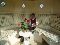 Octagonal summerhouse interior with made to measure seating and upholstery. Relax in style!