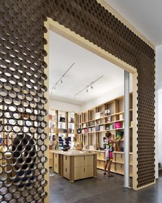 The exterior Woven Wood Screen is made of the composite material Prodema—an amalgam of paper and resin encased within a dual-sided wood veneer.