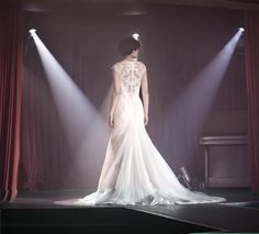 Exquisite extravagance 'Nina' from Donna Lee Designs creates a soft fishtail shape in silk satin & handmade lace with the low cut back adding extra glamour available in ivory only and at Pink Confetti from autumn 2013
