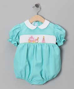 This precious bodysuit shows off detailed smocking, a comfy silhouette and a classically charming collar. Back buttons.
