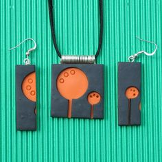 Polymer clay pendant: orange/black layers