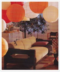 Canopy of paper lanterns over sofa (InStyle Parties)