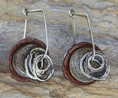 Threadache  Silver, copper, and sage glass earrings