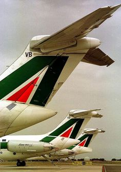 "Alitalia McDonnell Douglas MD-82 Tails.  I-DAVB ""Ferrara"", I-DABD ""Mantova"", and I-DAVV ""Pavia"" were just three examples of Alitalia's most prolific airliner."