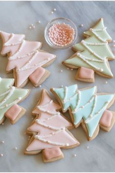 Fill in these chic christmas cookies with pink, blue, or green royal icing. Sprinkle sanding sugar on top and lay pink pearl nonpareils for decor. Get the recipe at Bake at 350.