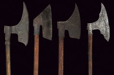 Poled axes Europe, 17th Century  All made of iron, with slightly curve-edged axe-blades pointed toward the top, one with two stamps at the centre. One with cusped humps at the back and provided with four-toothed mouth.