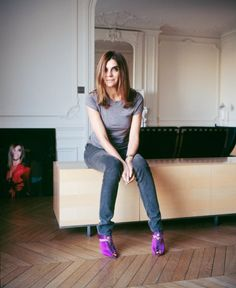 "Carine Roitfeld: ""From a very early age, French women learn not to exaggerate. Yves Saint Laurent once said that the purpose of clothes is to make women more beautiful but that a coat must never attract more attention than the woman wearing it."" ""I don't change my handbag every season. I believe in the Yves Saint Laurent woman who either has her hands in the pockets of her pantsuit or is holding her lover's hand. She doesn't need a bag..."""