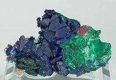 "Group of Azurite crystals with very well defined faces and edges, showing an intense blue color with good transparency. They are on limonite matrix with fibrous Malachite growths that have a silky (""velvet"") luster. A fine classic from Tsumeb. Tsumeb Mine, Tsumeb  Namibia"