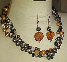 Wild pearls, copper beads, Swarovski crystals.  OOAK Maevyn's Lair original.