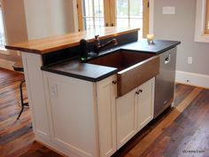 Swoon. Soapstone countertop with copper sink.