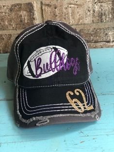 Super fun Basketball themed baseball cap! * ANY number or title can be done  * Distressed all over  * Leave a note at checkout with colors you would like for the name and #  * Curved brim  * Low profile  * Unstructured  * Velcro adjustable in back  * Ponytail pull through  * Vintage wash, cotton Football Love, Sports Mom, Team Names, Baseball Cap, Ponytail, Basketball, Profile, Number, Note