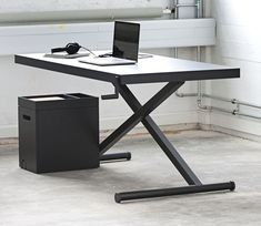 KiBiSi's Height-Adjustable XTable.  It uses a century old principle known from carjacks, ironing boards and other iconic tools.