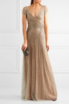 Gold sequined tulle Concealed hook and zip-fastening at back 100% polyester Specialist clean Designer color: Illusion