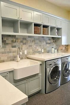 Like the mini clothes line under the cabinets, farmhouse sink, cubby hole cabinets