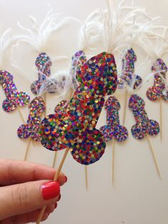 Multi Glitter Penis Cupcake Toppers / Picks with feathers - Perfect for Bachelorette Party or Hen Party!  Handmade and customizable penis party decor by Earles Folly on Etsy.  https://www.etsy.com/listing/455508726/bachelorette-or-hen-party-glitter-penis
