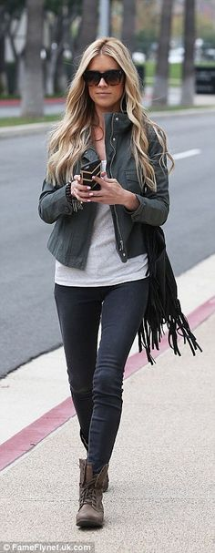 Uptown girl: Christina El Moussa was snapped last month in the well-heeled area of Newport Beach, California visiting court