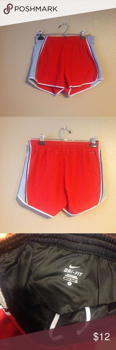 Red Nike Shorts Women's small red nike shorts. No nike logo on the front of the shorts. Dri fit on back. Liner included. Nike Shorts
