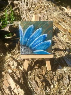 A personal favorite from my Etsy shop https://www.etsy.com/listing/540240733/blue-flower-on-green-and-gold-background