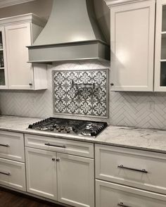 Now that's what we call a backsplash! Incredible work by & featuring our Florence 4 pattern from - Cement tile for the win.he backsplash may be). Metal Kitchen Cabinets, Kitchen Hoods, Kitchen Stove, Kitchen Cabinet Design, Kitchen Redo, Kitchen Tiles, Home Decor Kitchen, Kitchen Art, White Cabinets