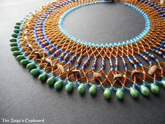 This gorgeous beaded broad collar features an alluring palette inspired by Alexandria on the Mediterranean sea.   I created this necklace with a variation on netting, incorporating a variety of beads