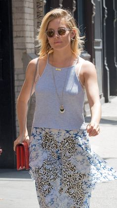 Sienna Miller is breezy beautiful in a grey tank top and a boho skirt