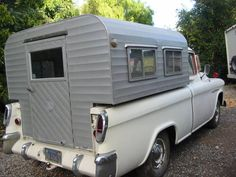 custom camper shell from craigslist.  not pictured is that inside, the loft bed is right below the windows. you'd have to crawl around in the lower level