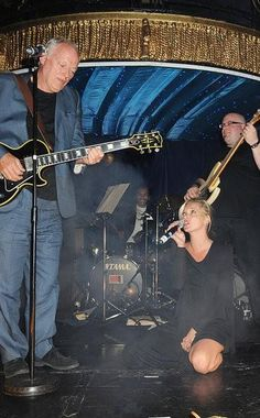 Kate Moss performs with Pink Floyd guitarist David Gilmour for charity