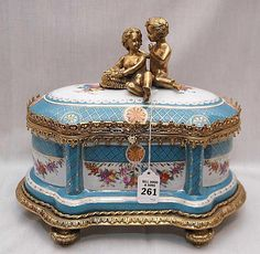 "Fine German porcelain and bronze box with bronze children on top, 12""l x 10""h"