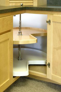 Steal back lost (and precious) storage in the far-away corners of cabinets by installing a lazy Susan. This turntable organizer also makes it easier to find containers that have been shoved to hard-to-reach corners.
