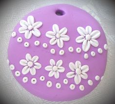 Polymer clay pendant, handmade with applique technique, one of a kind. Bright lilac, with white flowers and dots. By Lis Shteindel.