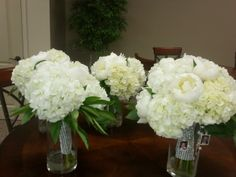 white hydrangea and white peony bouquets