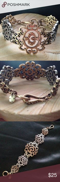 Lucky Brand Two Tone Floral Sun Open Work Bracelet Gently used, in great condition. Two tone gold and silver bracelet with snap closure. Lucky Brand Jewelry Bracelets