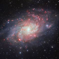 Galaxy M33 (Messier 33), often called the Triangulum Galaxy. This nearby spiral, the second closest large galaxy to our own galaxy, the Milky Way, is packed with bright star clusters, and clouds of gas and dust. - Image Credit: ESO Image enhancement: Jean-Baptiste Faure