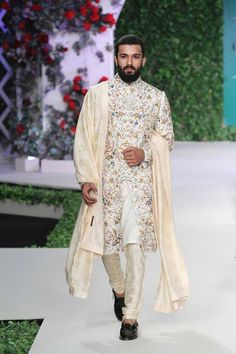 Love this floral ivory white sherwani from the collection Vintage Garden by Varun Bahl Sherwani For Men Wedding, Wedding Dresses Men Indian, Wedding Outfits For Groom, Sherwani Groom, Wedding Dress Men, Wedding Men, Punjabi Wedding, Wedding Ideas, Indian Weddings