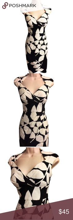 Stunning Black & White Print Maggy London Dress This stunning black & white print sheath dress from Maggy London is perfect for a special occasion or night out. Featuring cap sleeves & an elegant jewel neckline, the faux wrap dress is cinched below the bu