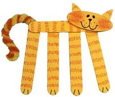 Craft Stick Kitty Refrigerator Magnet - using popsticks, cardboard for head & ears & pipecleaner for tail - instructions here
